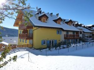 Использование блок-хауса при отделке фасадов отелей на горнолыжных курортах